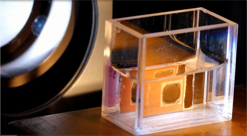 """This complex solar cell is coated with two different catalysts and works like an """"artificial leaf"""", using sunlight to split water and yield hydrogen gas."""