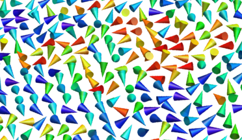 <p>The cones represents the magnetization of the nanoparticles. In the absence of electric field (strain-free state) the size and separation between particles leads to a random orientation of their magnetization, known as superparamagnetism</p>