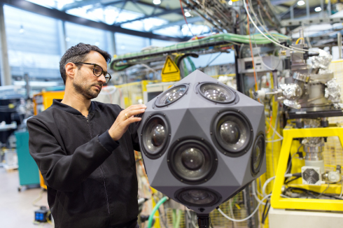 <p>Gerriet K. Sharma with a special icosaedron loudspeaker at BESSY II. Credit: M. Setzpfandt</p>