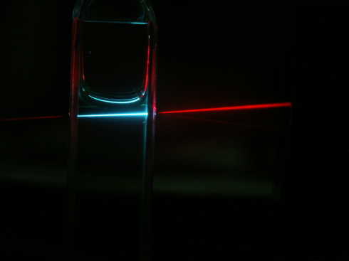 <p>The new organic material is able to &ldquo;add up&rdquo; low-energy photons (red) to yield higher-energy light (blue), which can then be harvested by the solar cell. </p>